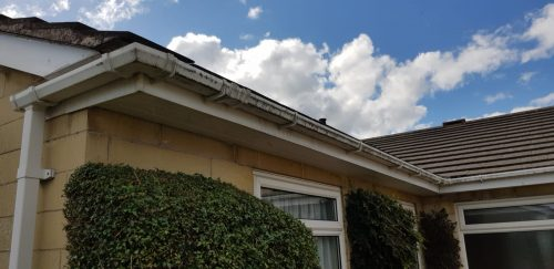 Gutter cleaning on a roof within Bath